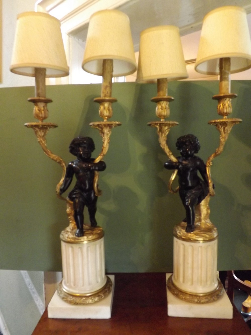 pair c19th french bronze cherub candelabras of louis xvi style in the manner of clodion