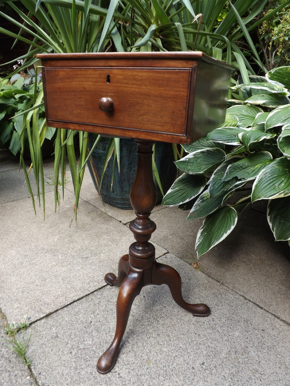 late c18th george iii period mahogany tripodbase table of unusual format