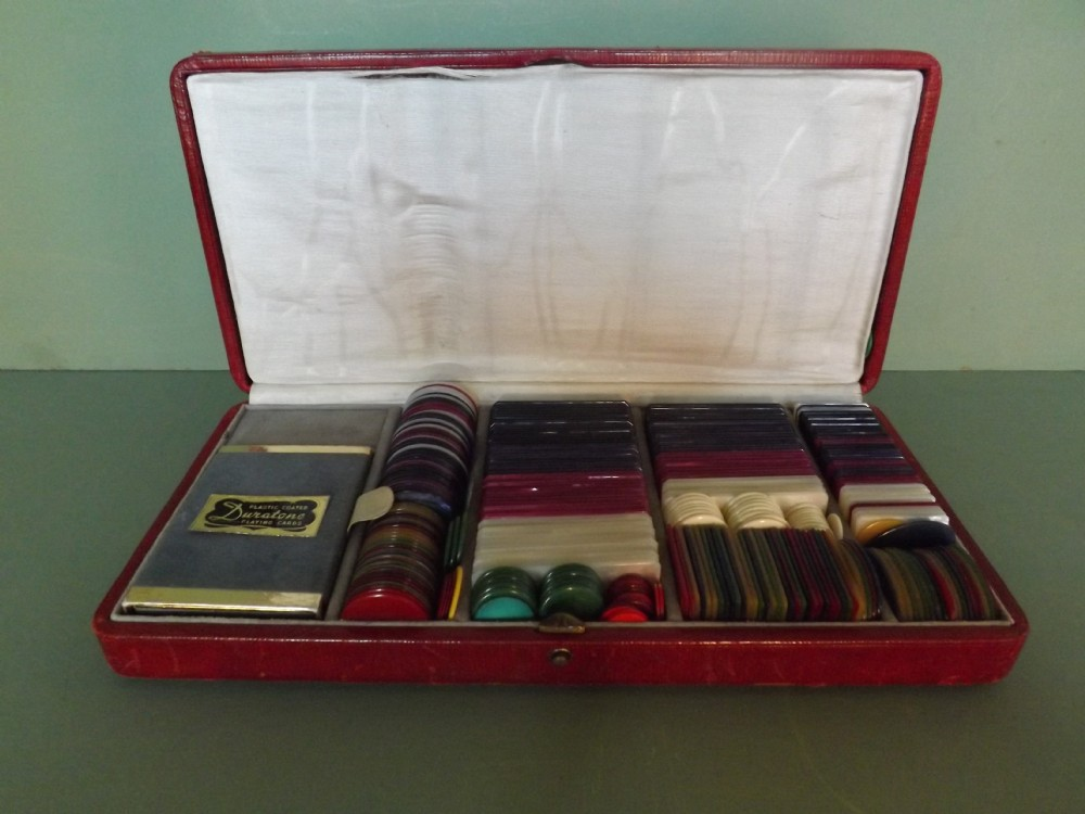 early c20th leathercased set of gamblingpoker chips