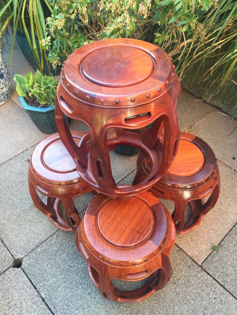set of 4 c20th chinese design hardwood barrelshaped garden seats or side tables