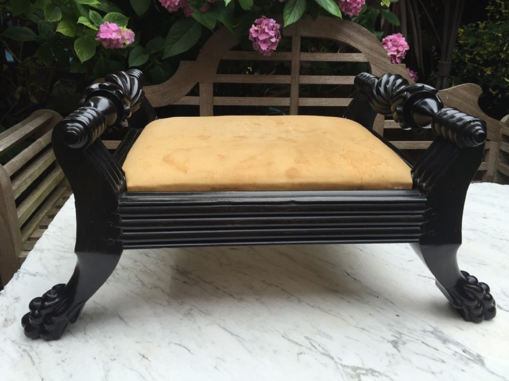 mid c19th angloindian ceylanese carved ebony footstool of scrollended form