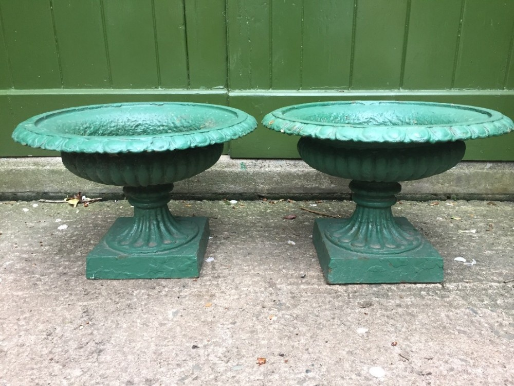 pair of small mid c19th castiron terrace wall or garden vases