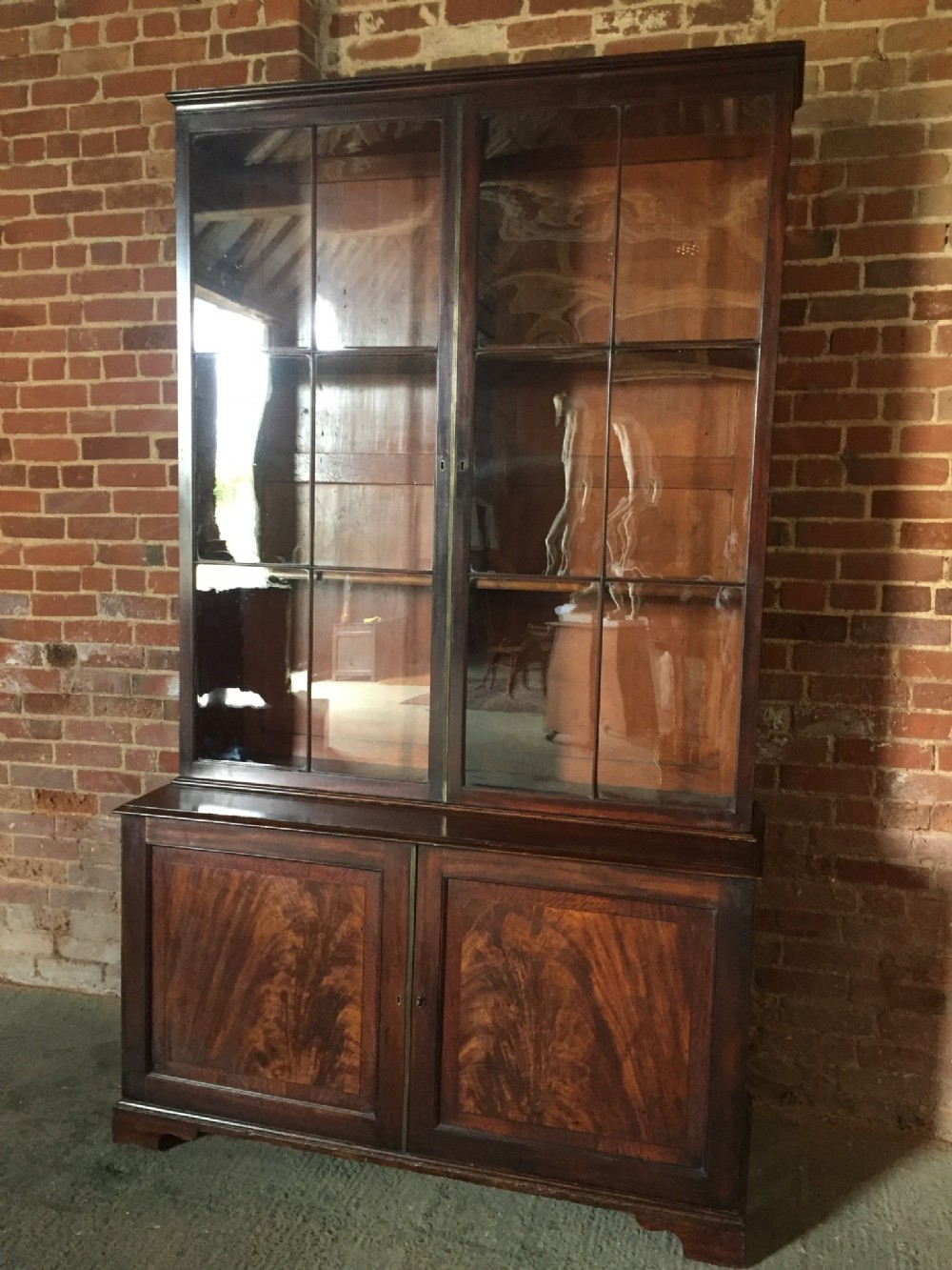 fine c18th early george iii period mahogany library bookcase with a fitted cupboard base in outstanding totally original and untouched condition