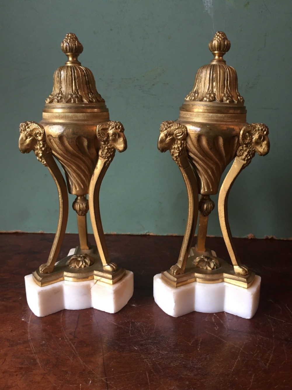 pair of c19th gilt bronze cassolettes of neoclassical design on white marble bases