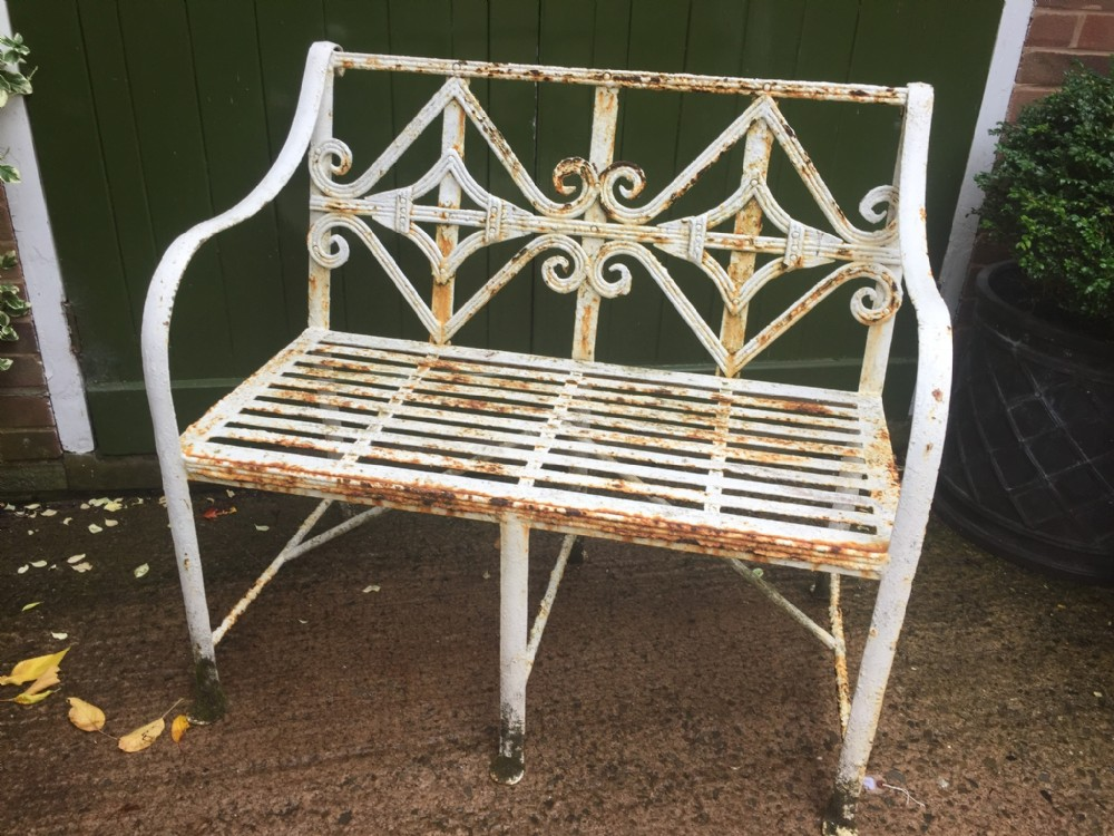 early c19th regency period wroughtiron garden seat of small proportions with intricately designed back