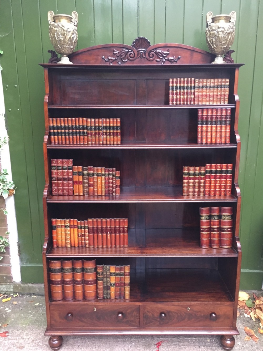 early c19th george iv period mahogany open bookcase of graduated 'waterfall ' design