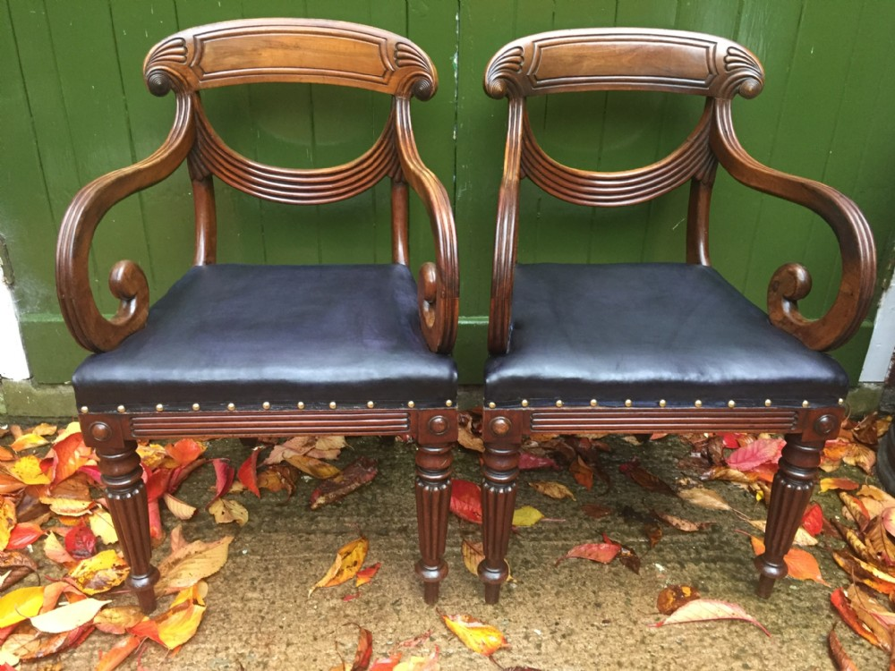 pair of early c19th regency period carved mahogany armchairs with stylish 'swag ' or lambrequin back splats