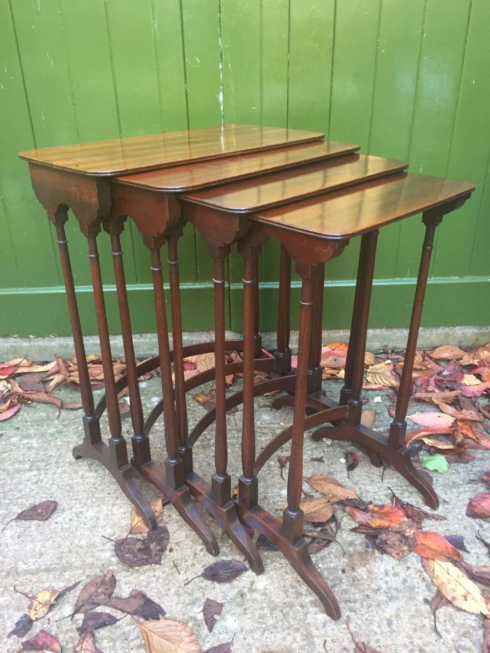 elegant early c19th george iv period 'quartetto' of nesting mahogany occasional tables