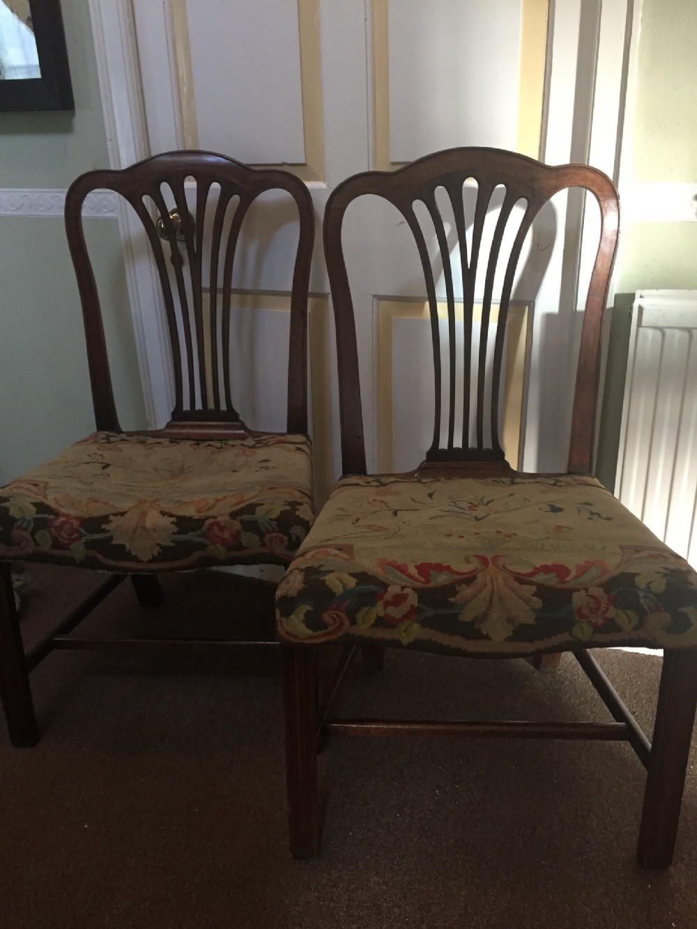 pair of c18th george iii period mahogany side chairs with original needlework seat covers