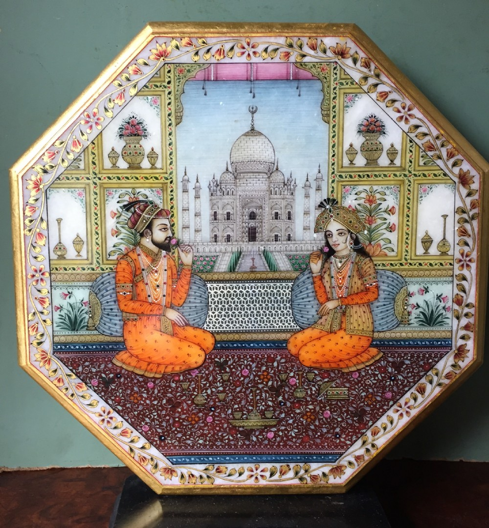 finely painted early c20th indian octagonal marble panel depicting shah jahan and mumtaz mahal posed on a carpet before the taj mahal in agra