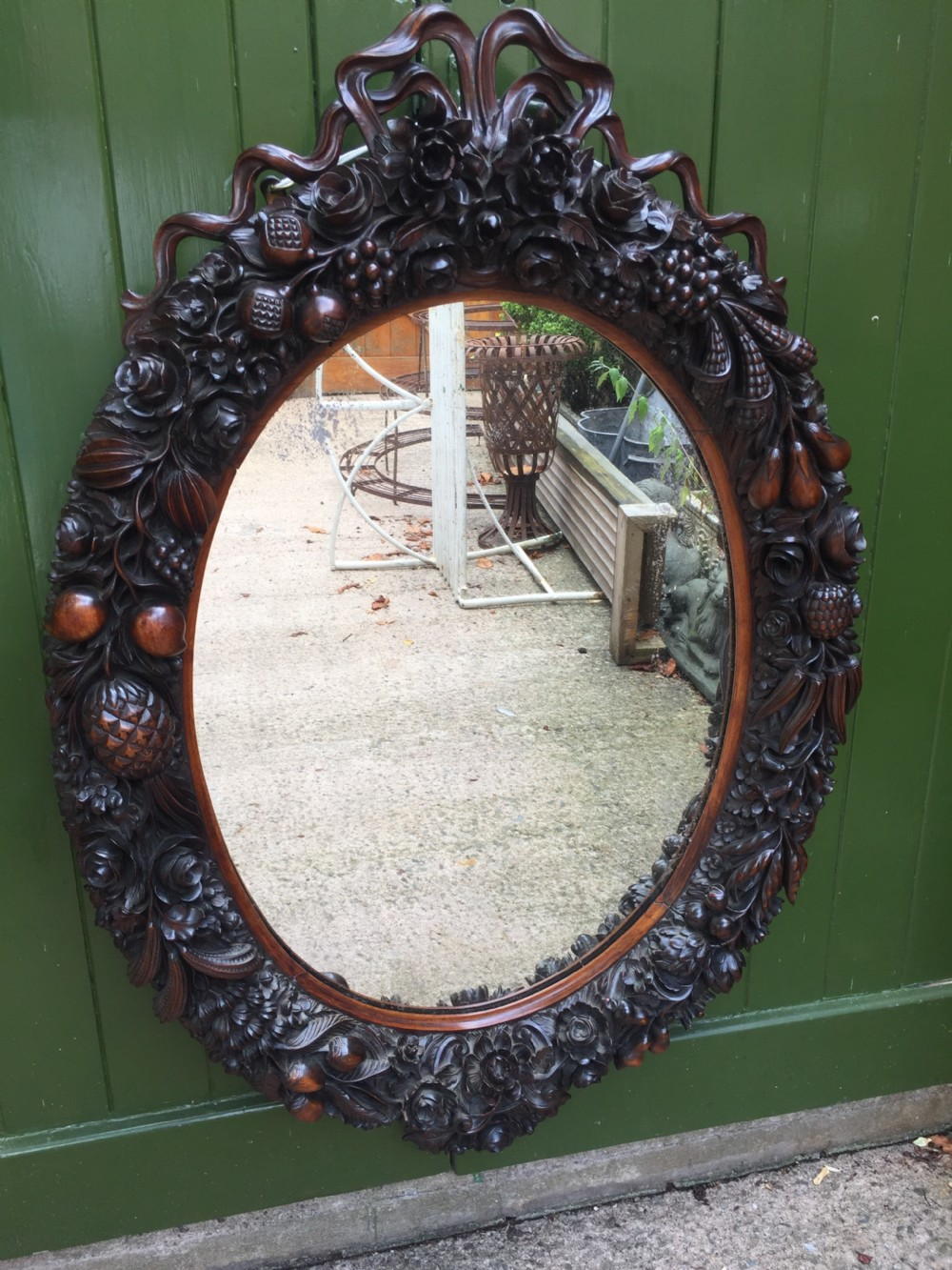 exceptional mid c19th indoportuguese carved rosewood or padouk framed oval mirror