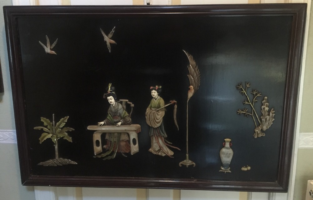 early c20th chinese lacquered panel with applied soapstone and composition decoration set in a hardwood frame