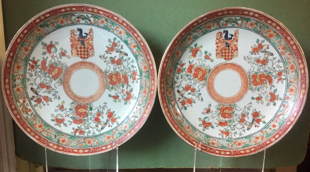 pair of c19th chinese style armorial porcelain dishes decorated in c18th style famille rose designs probably by samson paris