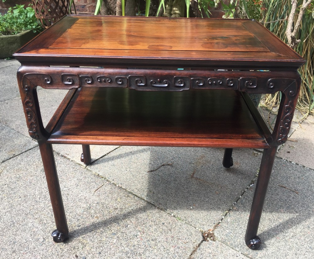 late c19th chinese qing dynasty carved hardwood 2tier centre table of freestanding design