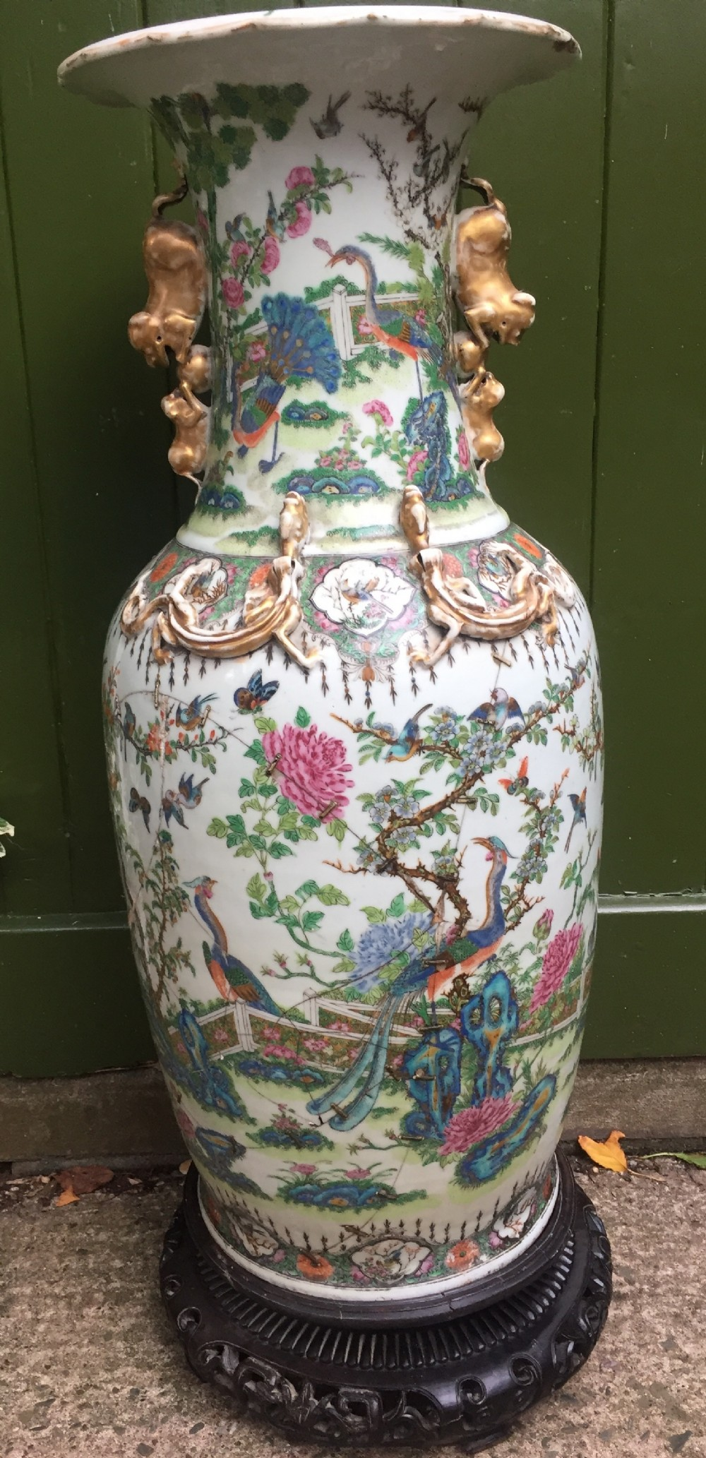 large scale c19th chinese cantonese porcelain enamel decorated vase on hardwood stand in repaired 'country house' condition