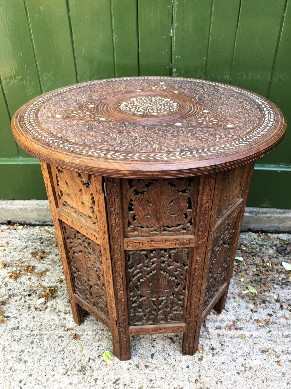 late c19th indian carved teak or shisham circular ivory inlaid table on octagonal folding base